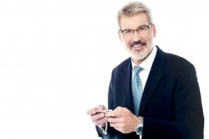 Senior Businessman Using Phone